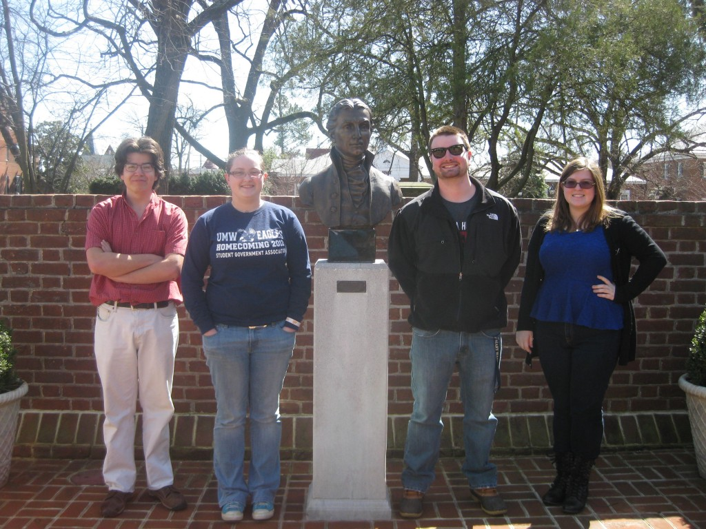 Ike Copperthite, Victoria Skaggs, Eric Greenlaw, and Amanda Vercruysse stand beside the bust of James Monroe at the James Monroe Museum.